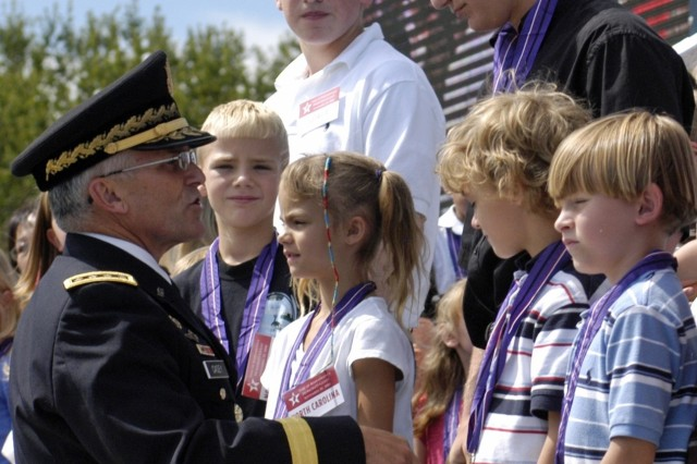Gen. Casey greets children of fallen warriors