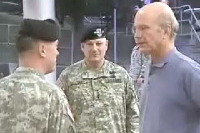 Secretary of the Army, Hon. Pete Geren, is greeted by the Commander of LRMC, Col. Brian C. Lein.