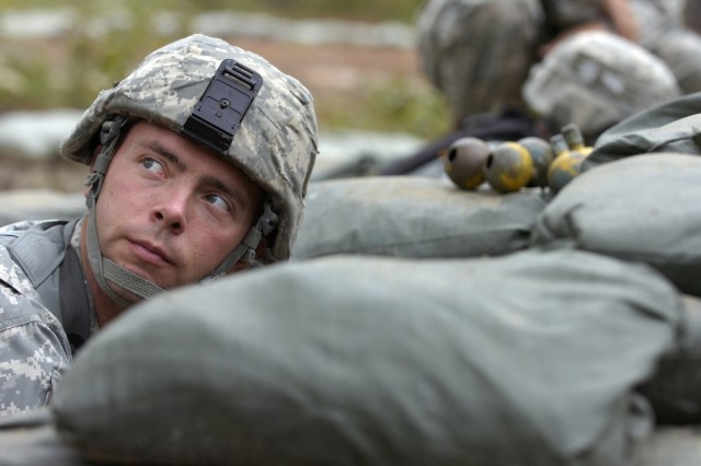 Spc. Chad Truelove, a Dimone, Iowa, native, listens to an instructor at the Expert Infantryman Badge train-up for instructions at the hand grenade lane on Sept 16. Truelove, a Paratrooper from Company A, 2nd Battalion, 325th Airborne Infantry Regiment, 2nd Brigade Combat Team, 82nd Airborne Division, had to identify the different types of hand grenades as well as throw several hand grenades within five meters from a target.