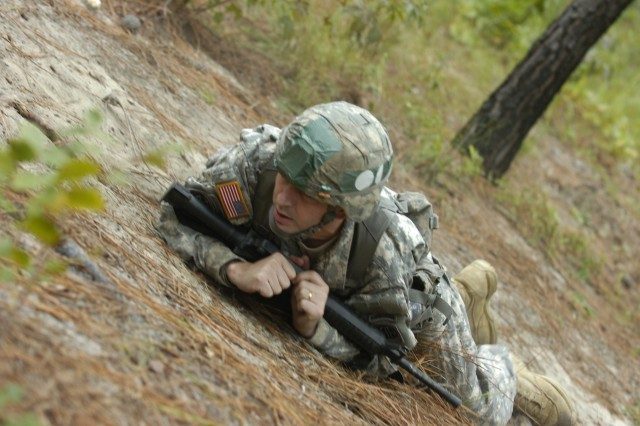 Spc. Matthew Young, a Winston Salem, N.C. native with Company C, 2nd Battalion, 325th Airborne Infantry Regiment, 2nd Brigade Combat Team, 82nd Airborne Division, practices moving under direct fire during the train- up for the Expert Infantryman Badge on Sept. 16.
