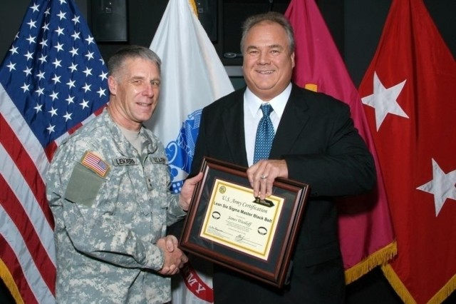 Maj. Gen. William M. Lenaers presents Jim Wasiloff with the Department of the Army Master Blackbelt Certificate.