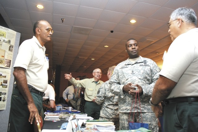 Army Sgt. 1st Class Raymond Arnold, of the 32nd Medical Brigade at Fort Sam Houston, meets with U.S. Forest Service recruiters Ted Willis (left) and Fred Salinas Sept. 23 at the Hiring Heroes Career Fair at the Sam Houston Club. Nearly 80 employers from federal and state agencies and private companies had information booths at the fair.