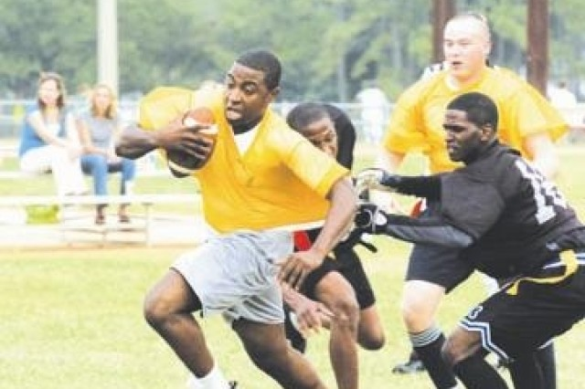 Tavares Garrett, quarterback with Co. A, 3/69 Armor, attempts to avoid pressure from 26th BSB during the Fort Stewart Intramural Flag Football League play, Sept. 17.