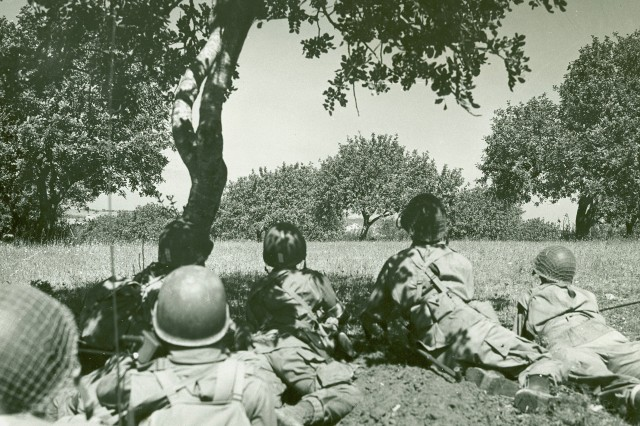 U.S. Paratroopers, identified as being members of the 82nd Airborne Division, advance through the Sicilian countryside after a night landing. Gela, Sicily,11 July 1943. (WW2 Signal Corps Photograph Collection).