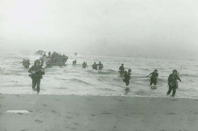 Image shows members of the 143rd Infantry Regiment, 36th Infantry Division coming ashore during amphibious landings at Salerno, Italy; 9 September, 1943.(WW2 Signal Corps Photograph Collection).