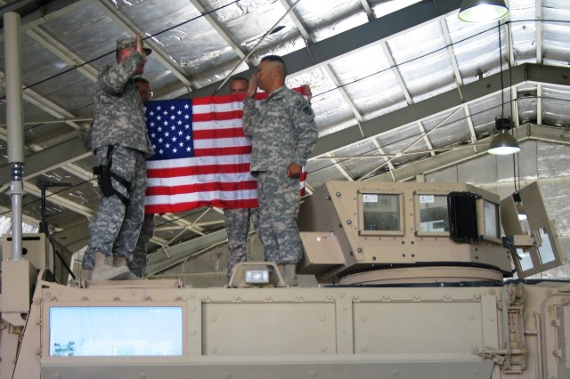 Lt. Col. Donald Mayer, commander, 3rd Battalion, 401st Army Field Support Brigade, administers the oath of enlistment to Sgt. 1st Class Tony Reyes during a reenlistment ceremony held atop a Mine Resistant Ambush Protected Vehicle at Bagram Airfield, Afghanistan, Sept. 21, 2008.  Holding the U.S. flag for the event are (L-R) Master Sgt. James Gunkleman and Staff Sgt. Carlos Rosado-Mejia of 3rd Battalion.
