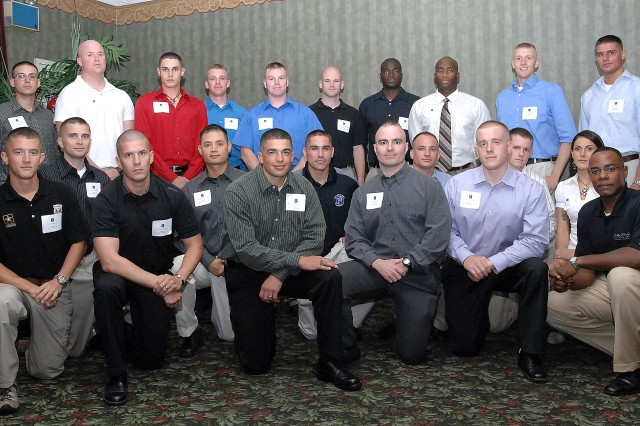 """The 24 Soldiers and noncommissioned officers from 12 major commands gathered Sept. 28 for a Welcome Social to kick off the 2008 Department of the Army NCO/Soldier of the Year """"Best Warrior"""" Competition at Fort Lee, Va."""