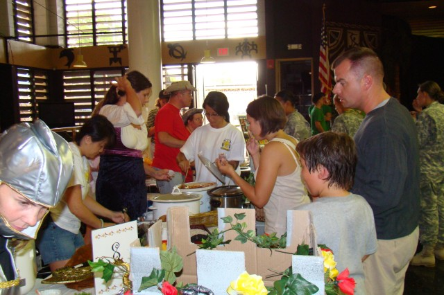 SCHOFIELD BARRACKS, Hawaii - More than 250 hungry Soldiers, civilians and family members sample chili at the FRG Chili Cook-Off, held Sept. 19 at the Tropics.
