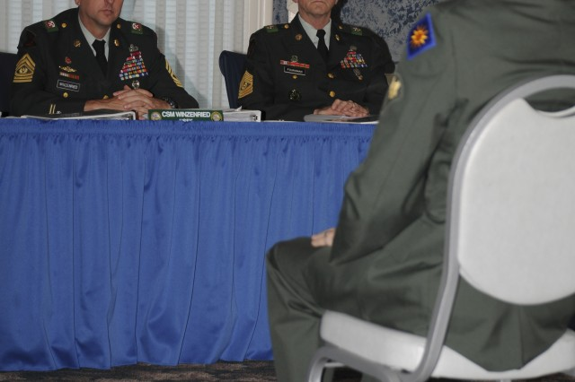 Spc. Jeremy Whipple, U.S. Army National Guard competitor, sits before the panel at the board apperance Sept. 29, during the 2008 Department of the Army NCO/Soldier of the Year Competition at Fort Lee, Va.