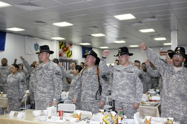 Soldiers from the 27th BSB, 4th BCT, 1st Cav. Div. participate in the 'Cavalry Charge' during the battalion's 87th birthday celebration at the COB Adder dining facility.  The battalion was activated the same year the 1st Cav. Div.