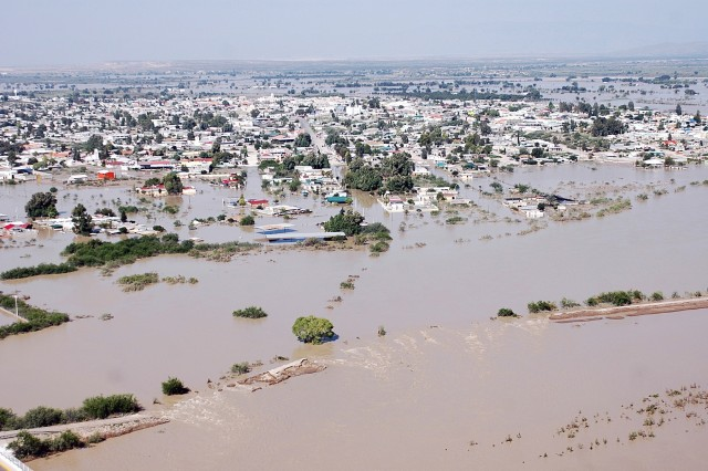 """Towns in Mexico near the Rio Grande are under water due to flooding from the river. The CH-47F pilots and crewmembers from Company B """"Black Cats,"""" 2nd Battalion, 227th Aviation Regiment, 1st Air Cavalry Brigade, 1st Cavalry Division, are on a mission to stop that from happening to Presidio, Texas, by dropping huge sandbags on a levee threatening to overflow. The Black Cats have been dropping the sandbags since Sept. 19."""