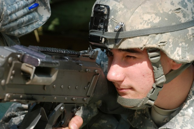 Pfc. John Rumsey, a Tocoma, Wa., native from C Troop, 1st Squadron, 73rd Cavalry Regiment, 2nd Brigade Combat Team, 82nd Airborne Division, prepares a range card for the M240B machine gun during practice for the Expert Infantryman Bade September 29.  (U.S. Army photo by Sgt. Susan Wilt, 2nd BCT, 82nd Airborne Division PAO)