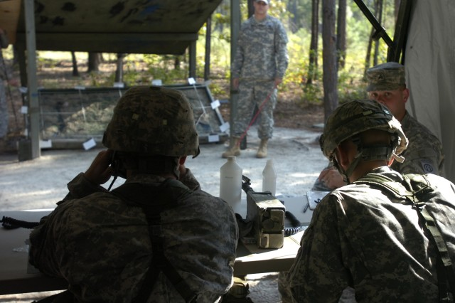 Two Paratroopers from 1st Battalion, 325th Airborne Infantry Regiment, 2nd Brigade Combat Team, 82nd Airborne Division practice adjusting a target for indirect fire during practice for the Expert Infantryman Badge on September 29.  (U.S. Army photo by Sgt. Susan Wilt, 2nd BCT, 82nd Abn. Div.)