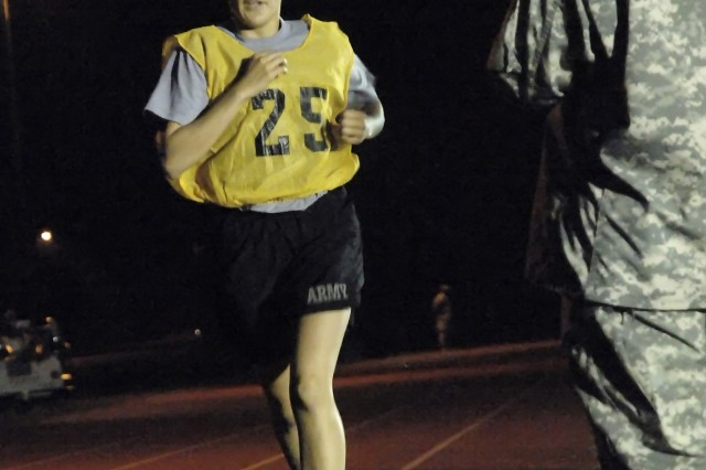 Sgt. Lisa Morales, U.S. Army Forces Command, keeps pace during the two-mile run portion of the Army Physical Fitness Test. The APFT was the first event Oct. 1 of the 2008 Department of the Army NCO/Soldier of the Year Competition. Photo by Mike Strasser, Fort Lee Public Affairs