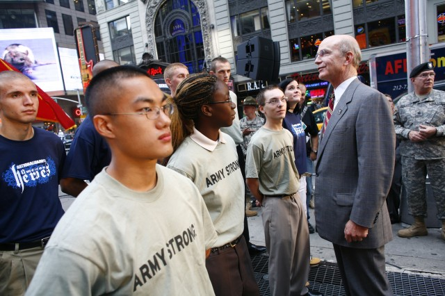 Secretary of the Army Pete Geren talks with a future enlistee prior to a swearing-in ceremony in front of the Times Square Recruiting Station in New York City.