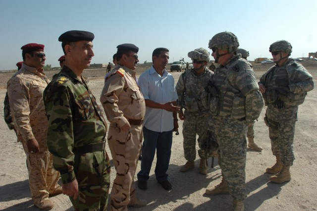 Col. Mark Barbosa, commander of the 7th Sustainment Brigade, meets with Iraqi Army officials Sept. 30 at Abdul Razaq, Iraq. 7th SB and IA members joined local officials in a ribbon-cutting ceremony to open Abdul Razaq's water purification unit.
