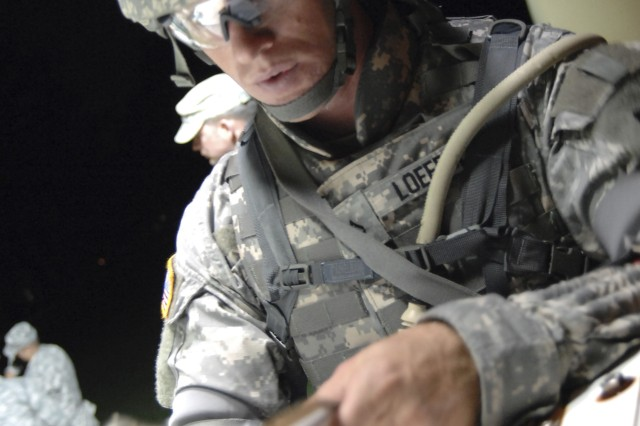 Pfc. Christopher Loeffler, Army Materiel Command, plots waypoints during the night urban warfare orienteering course Oct. 1, at the 2008 Department of the Army NCO/Soldier of the Year Competition at Fort Lee, Va. Photo by Mike Strasser, Fort Lee Public Affairs
