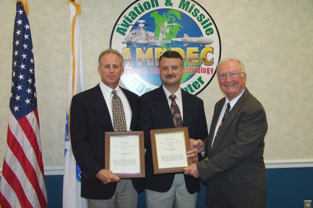 Dr. William C. McCorkle (right), Director of the U.S. Army Aviation and Missile Research, Development and Engineering Center congratulates inventors Jeffrey K. Levasseur (left) and Brent A. Worley (center), who are electrical engineers in the Advanced Technology Division of the Weapons Development and Integration Directorate.