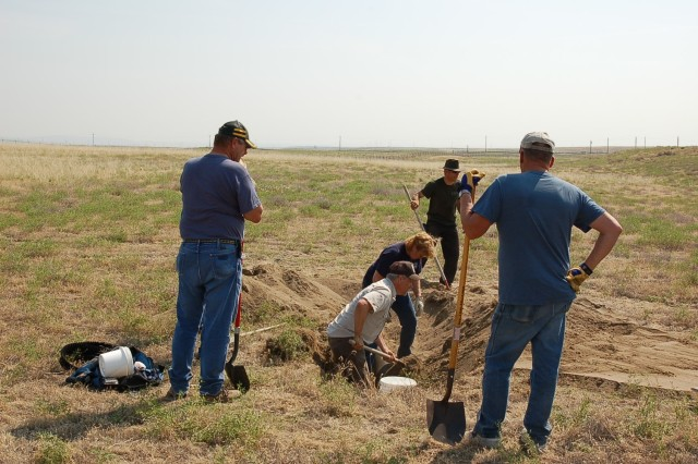"A team of Army and US Fish and Wildlife Service staff and volunteers from both on post and the community work hard to cover an artificial burrow or ""owl condo"" for Burrowing Owls at the Umatilla Chemical Depot. Photo courtesy of US Army."