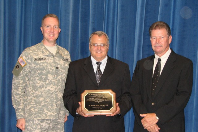 Accepting the award are, from left, Garrison commander Col. Bob Pastorelli, chief of environmental management division Terry Hazle and director of public works Joe Davis.