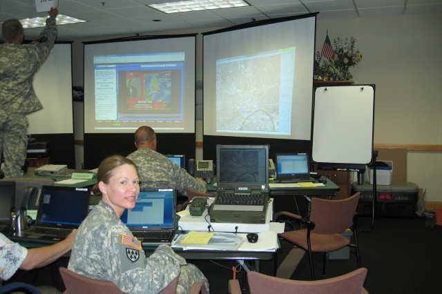 Members of the National Guard use Blue Force Tracking-Aviation at their joint operations center during the Republican National Convention.