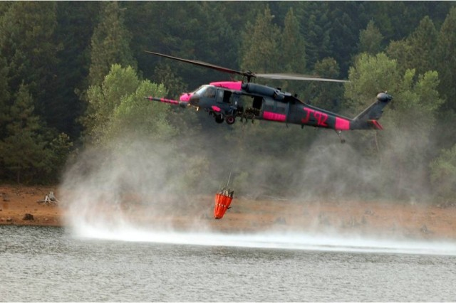 A helicopter equipped with Blue Force Tracking-Aviation supports wildfires operations.