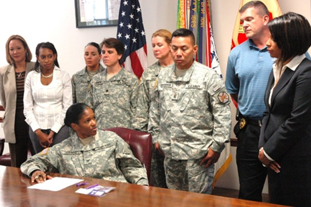 Col. Deborah B. Grays, commander, U.S. Army Garrison, Fort McPherson and Fort Gillem, signed a proclamation Tuesday in the presence of staff members who serve as advocates for families in need.  The proclamation designates October as National Domestic Violence Awareness Month.