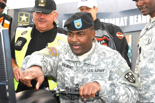 Staff Sgt. Rashad Valmont, Army medical Professional Command in Morrow, Ga., reviews his riding skills after completing a simulated ride on the Safe Motorcyclist Awareness and Recognition Trainer (SMART) system provided by the U.S. Army Combat Readiness Center.
