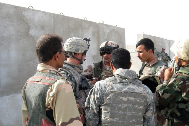 First Lieutenant Jordan Hill, of 2nd Bn., 7th Cav. Regt., 4th BCT, 1st Cav. Div. conducts a pre-mission brief with leaders from the 38th IA Bde. at FOB Garry Owen Sept. 28.