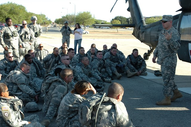 Staff Sgt. Christopher Orange, a flight medic with Company C, 2nd Battalion, 227th Aviation Regiment, talks Soldiers from the 154th Transportation Company, 180th Transportation Battalion, 15th Sustainment Brigade, 13th Sustainment Command (Expeditionary), through medical evacuation procedures during medevac training Oct. 2 at Fort Hood.
