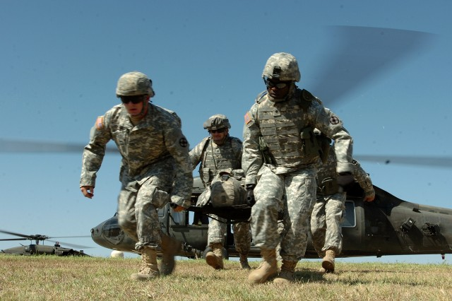Soldiers from the 154th Transportation Company, 180th Transportation Battalion, 15th Sustainment Brigade, 13th Sustainment Command (Expeditionary), carry a fellow Soldier away from a medical evacuation helicopter during medevac training Oct. 2 at Fort Hood. (U.S. Army photo by Staff Sgt. Rob Strain, 15th Sustainment Brigade Public Affairs)