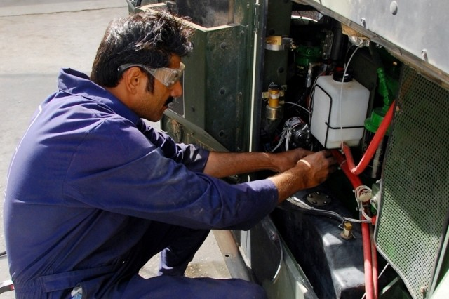 Generator mechanic Ijaz Ahmad, a Middle East Business Solutions Co. employee from Faisalabad, Pakistan, applies a modification to the fuel cell of a 60 kW generator, Sept. 29, 2008, at the U.S. Army Communications-Electronics Command Electronics Sustainment Support Center, Camp Arifjan, Kuwait.  To date, the ESSC's Generator Repair Facility staff has repaired or overhauled more than 1,000 generators during Fiscal Year 2008.  Generators serviced by the ESSC are either returned to units conducting operations in Southwest Asia, or returned to stock as part of the National Maintenance Program, which implements the Army's policy of repair as the primary source of supply.