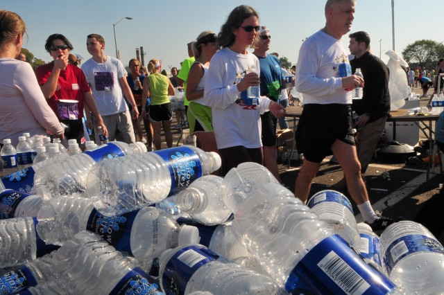 Runners pass by thousands of empty water bottles during the annual Army Ten-Miler held in Washington, D.C. Oct. 5. More than 26,000 runners from 40 countries participated.