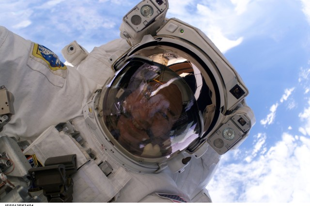 Astronaut Col. Jeffrey N. Williams (Ret.), Expedition 13 NASA space station science officer and flight engineer, is photographed during a 5-hour, 54-minute excursion which he shared with European Space Agency astronaut Thomas Reiter (out of frame), Aug. 3, 2006. For part of the spacewalk, the pair worked closely in tandem, and then worked separately, getting ahead of their timeline, thus enabling the two to tack on extra tasks.