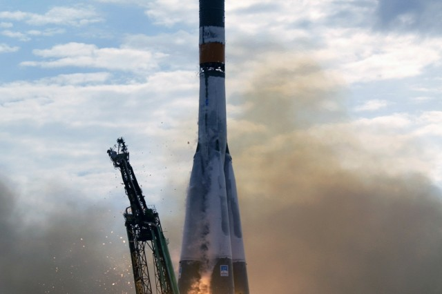 A Soyuz spacecraft lifts off from the Baikonur Cosmodrome, Kazakhstan, at 10:54 p.m. (CDT) on April 26, 2003.  Col. Jeff Williams (Ret.), is scheduled to travel to the International Space Station on a Soyuz spacecraft in 2009.