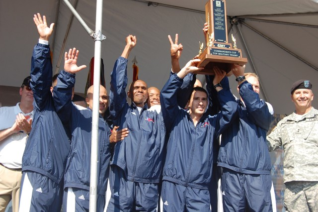 The Army 10-Miler men's team from Fort Bliss, Texas, holds their trophy aloft after accepting the first place award for the men's category from Maj. Gen. Richard Rowe Sunday in Arlington, Va.  The Fort Bliss Women's Team took third place in the women's category.
