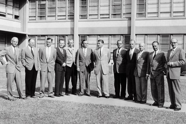 Twelve scientific specialists of the Peenemuende team stand at the front of Building 4488, Redstone Arsenal, Huntsville, Ala. They led the Army's space efforts at ABMA before the team transferred to the National Aeronautics and Space Administration's George C. Marshall Space Flight Center. (Left to right) Dr. Ernst Stuhlinger, Dr. Helmut Hoelzer, Karl L. Heimburg, Dr. Ernst Geissler, Erich W. Neubert, Dr. Walter Haeussermarn, Dr. Wernher von Braun, William A. Mrazek, Hans Hueter, Eberhard Rees, Dr. Kurt Debus, and Hans H. Maus.