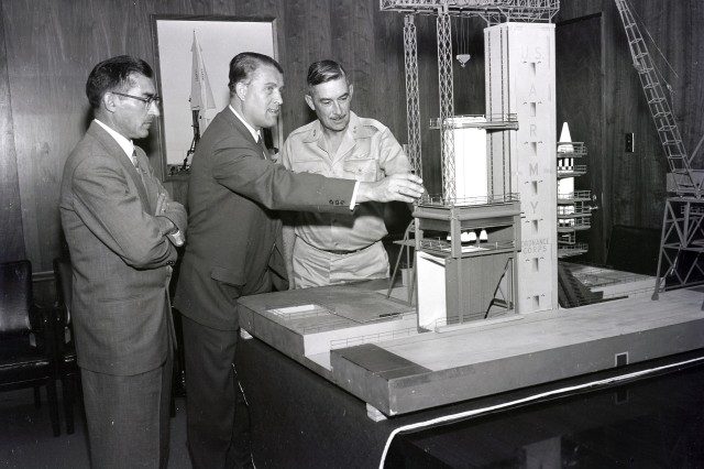 (From left to right) Karl L. Heimburg, director of the Test Laboratory; Dr. Wernher von Braun, director of the Development Operation Division; and Maj. Gen. John B. Medaris with the model of the S-1B Test Stand. Gen. Medaris was the commander of the Army Ballistic Missile Agency in Redstone Arsenal, Ala., from 1955 to 1958.