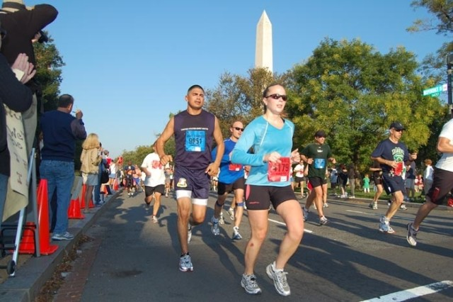 Sgt. 1st Class Roger Garcia of the United States Army South Army Ten-Miler Team (number 9851) runs by the Washington Memorial during the Sunday morning race in Washington, D.C., which included over 26 thousand runners from around the world.