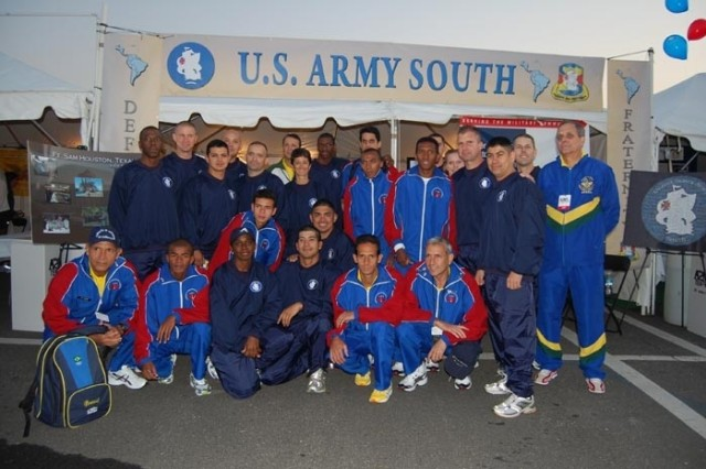 The United States Army South Army Ten-Miler Team takes a moment to pose for a photograph alongside members of the Brazilian Armed Forces team just before the Sunday morning race in Washington, D.C.