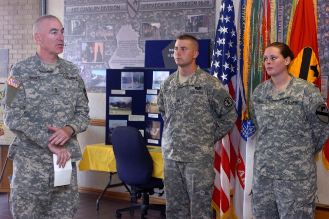 Maj. Gen. Daniel P. Bolger, commanding general, 1st Calvary Division praises Winfield, Kan. native Sgt. Nathan Hayes, 64th Military Police Company, 720th MP Battalion, 89th MP Brigade, and San Antonio native, Pfc. Ryann Gilmore, a nuclear, biological and chemical specialist from Company B, Division Special Troops Battalion for their commitment and dedication to the Army during a reenlistment ceremony Sept. 22 at Fort Hood, Texas. In a few brief comments, Bolger explained to the crowd the sacrifices involved in enlisting for a longer term, and he thanked the Soldiers for their service.