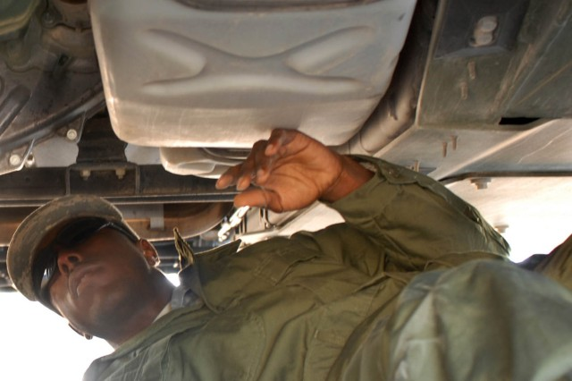 Atlanta Ga. Native Pvt. Daryl Martin, a generator mechanic (32D) with A Company 1st Brigade Support Battalion, 1st Brigade Combat Team, 1st Cavalry Division inspects the under riggings of his gun truck for signs of a leak or rusted conditions to ensure vehicle operability during 1BCT's training at the National Training Center at Fort Irwin, Calif. Oct. 4.