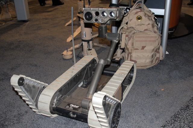 A Small Urban Ground Vehicle on display at the Program Manager Future Combat Systems display during the AUSA exposition October 6, 2008. Soldiers from the Army Evaluation Task Force recommended the SUGV be equipped with a camera in the main body so if the head was damaged, the robot could continue to operate. The recommendation was incorporated into the latest design; the body-camera can be seen at the bottom of the robot between the treads.