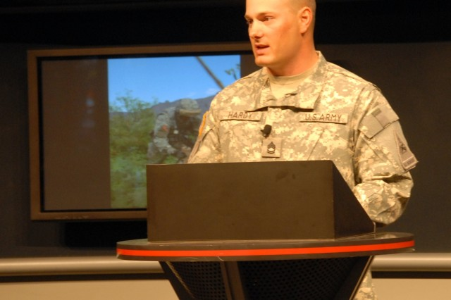 """Sgt. First Class Joseph Hardy addresses the audience during his presentation, """"A Future Combat Systems Embedded Army,"""" at the Army Exhibit during the Association of the United States Army exposition on October 6, 2008."""