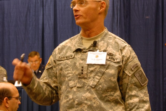 """Lt. Gen. Jeffery A. Sorenson, the Army's chief information officer/G-6, interacts with the audience during the panel discussion """"Transforming LandWarNet for the Warfighter"""" at the Association of the United States Army conference, Oct. 6."""