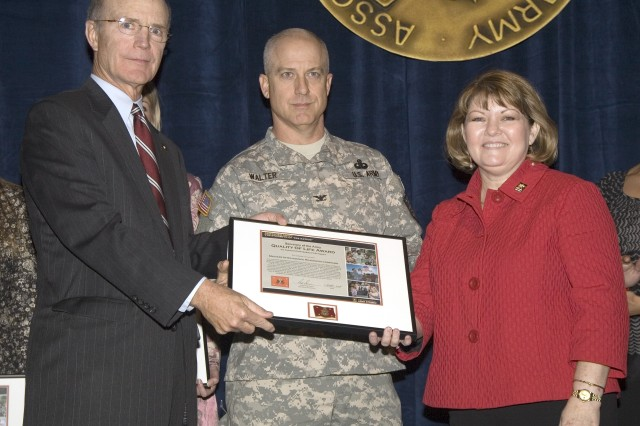 Col. Robert Walter, deputy commanding officer, Military Intelligence Readiness Command (center), and Laura Stults, wife of Commanding General of the  U.S. Army Reserve Lt. Gen. Stults, accept the Command Team Quality of Life Award on behalf of the Military Intelligence Readiness Command.  Secretary of the Army Pete Geren (left) presented the awards Oct. 7 at the 2008 Association of the United States Army Annual Meeting in Washington, D.C.