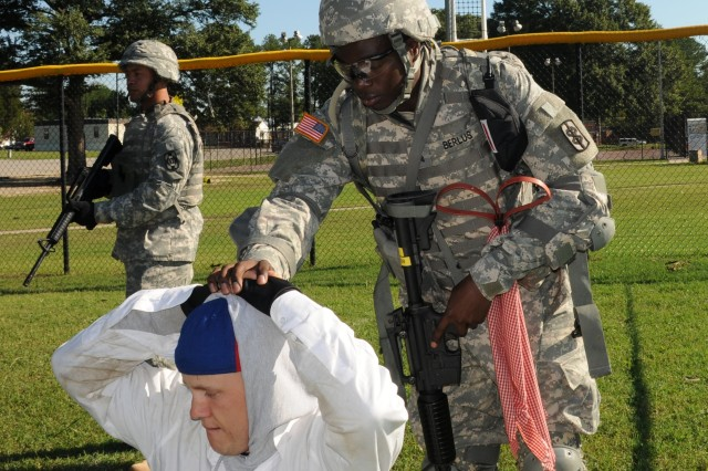 Sgt. Victor Berlus, Eighth U.S. Army Korea, conducts a Detainee Operations scenario Oct. 2 during the Warrior Tasks and Battle Drills event at the 2008 Department of the Army NCO/Soldier of the Year Competition at Fort Lee, Va.