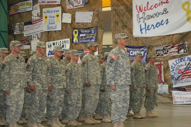 Col. Timothy Edens, commander of the 12th Combat Aviation Brigade, leads a formation of Griffin Soldiers into Hangar 2 during a welcome home ceremony on Katterbach Kaserne, Germany Sept. 25.