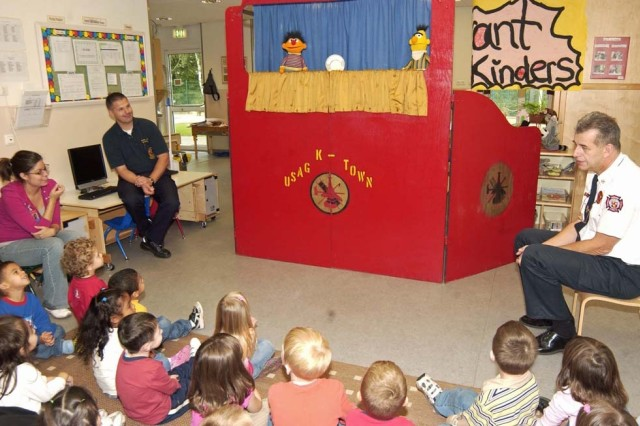 """Bert & Ernie,"" from Sesame Street fame, talk about the importance of fire detectors in the ""Metal Cookie"" skit Oct. 7 for preschoolers at the U.S. Army Garrison Kaiserslautern Child Development Center on Landstuhl Regional Medical Center, Germany For the past 22 years, the garrison's fire department has performed the ""Sesame Street"" puppet theater in observance of National Fire Prevention Week."