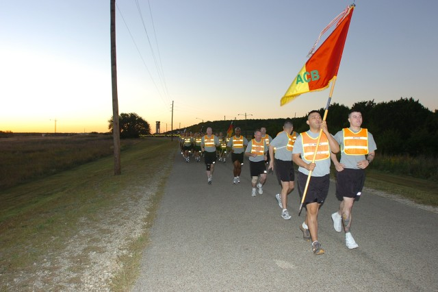 "Even before the sun peaks over the horizon, the troopers of the 1st Air Cavalry ""Warrior"" Brigade, 1st Cavalry Division, head out on a unit run at West Fort Hood, Texas, to boost morale before their four-day weekend, Oct 9.  Colonel Douglas Gabram, commander of the Warriors, said the overall message for the holiday weekend was safety, taking care of one another and the importance of family."